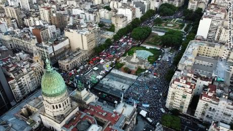 Abortion-rights activists, left, and activists against abortion, right, rally outside Argentina's Congress in the capitol of Buenos Aires on Tuesday as lawmakers debated a bill that legalized abortion.