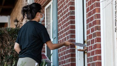 Youth organizers are going door to door to encourage young Georgians to vote in the Senate runoff.