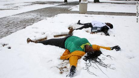 Baylor University students make snow angels after at least five inches was reported throughout Central Texas on Sunday.