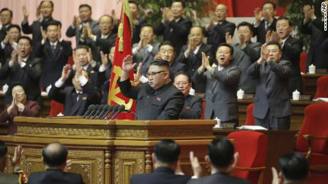 In this photo provided by the North Korean government, North Korean leader Kim Jong Un, center, is seen after he made his closing remarks at a ruling Party Congress in Pyongyang on Tuesday.