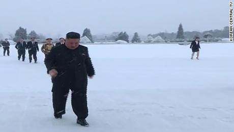 Kim Jong Un and his sister Kim Yo Jong (in the back right) are seen walking in the snow in footage aired by North Korean state media.