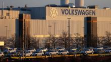 Trains with electric vehicles stand in front of the Volkswagen plant in Zwickau. The company is producing its first electric SUV at the factory.