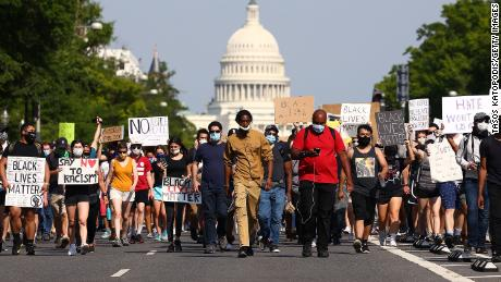 Demonstrators march down Pennsylvania Avenue  during a protest against police brutality and the death of George Floyd on June 3, 2020, in Washington.