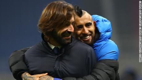 Arturo Vidal hugs former Juventus teammate Andreo Pirlo at full time.