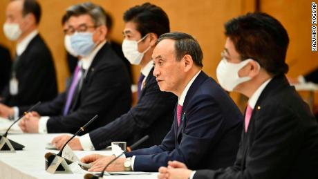 Japanese Prime Minister Yoshihide Suga, second from right, speaks during a meeting of the coronavirus infection control headquarters at his office in Tokyo on Friday, January 22.