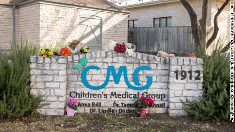 Flowers are left at Children's Medical Group on West 35th Street on January 27, 2021.
