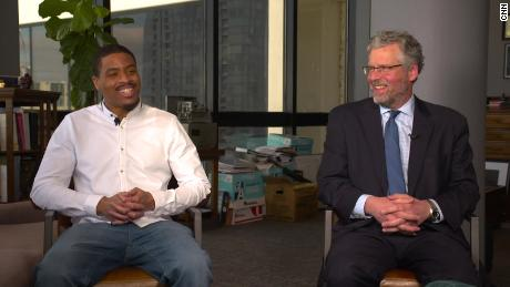 Chris Young, left, and former judge Kevin Sharp smile in an interview with CNN on January 28 in Nashville.