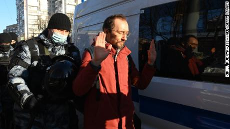 Law enforcement officials detained a man outside Moscow City Court on Tuesday ahead of Navalny's hearing.