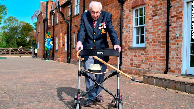 Captain Tom Moore poses with his walking frame while doing a lap of his garden on April 16, 2020.