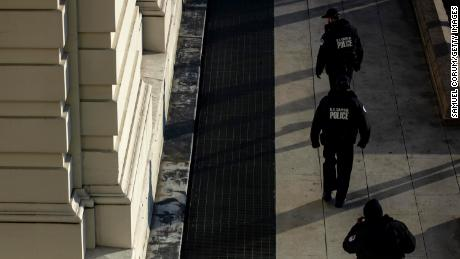 Capitol Police officers sweep the grounds of the U.S. Capitol building on January 7, 2021 in Washington, DC.