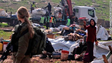 A resident reacts as Israeli forces demolish tents and structures near Tubas on February 8.