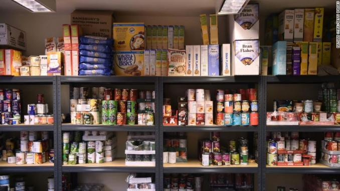Cans of food are left on the shelves at a food bank in Newcastle-under-Lyme, England.
