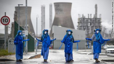 Activists from Extinction Rebellion Scotland stage a blockade on the road outside the Ineos oil refinery at Grangemouth.
