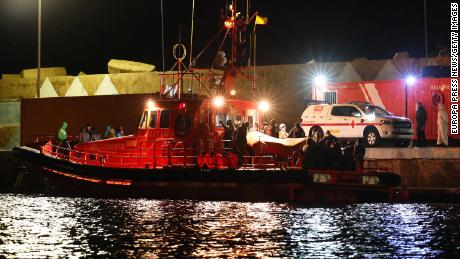 A group of migrants arrive at Fuerteventura in the Canary Islands on January 25, 2021. Their boat was carrying 52 men, eight women and three minors.