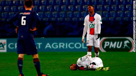 Neymar writhes in pain after suffering an injury during a French Cup match against Cean last week.