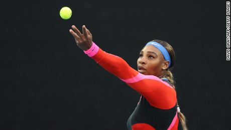 Williams serves against Halep during their women's singles  match.