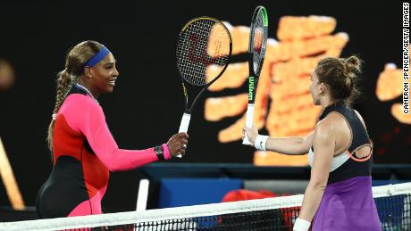 Williams and Halep touch racquets at the net following match.