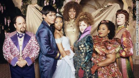 """(From left) Jason Alexander, Paolo Montalban, Brandy, the late Whitney Houston, Bernadette Peters, the late Natalie Deselle Reid and Veanne Cox led the cast in """"Rodgers & Hammerstein's Cinderella."""""""
