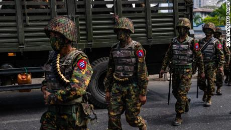Myanmar military soldiers from the 77th Light Infantry Division stand guard armoured vehicles on February 15, 2021 near the Central Bank in Yangon, Myanmar.