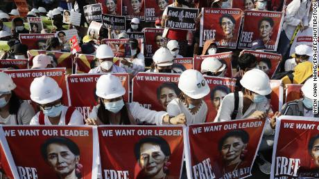 Civil engineers held placards on 17 February 2021 during a protest against the Myanmar military coup outside the US embassy in Yangon, demanding the release of state counselor Aung San Suu Kyi.