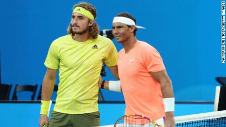 Tseetipas and Nadal pose before their match.