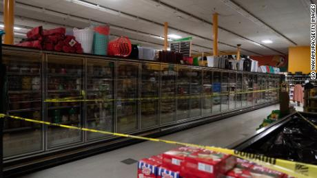 The freezer sections are closed at Fiesta Supermarket on Tuesday in Houston, Texas.