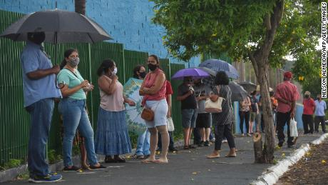 Residents line up to receive the Coronavac vaccine against COVID-19, in Serrana, about 323 km from Sao Paulo, Brazil, on February 17, 2021.