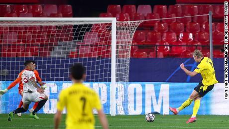 Haaland scores Dortmund's third goal against Sevilla.