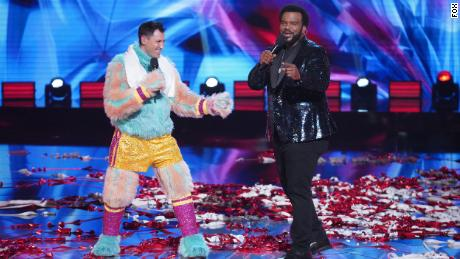 MASKED SINGER: LR: Makisim Charmakovsky and host Craig Robinson & quot;  Road to the Final - Final Clue to the Mask!  / The Finale - One Last Mask!  & Quot;  The special two-hour season finale of Dancers aired on Wednesday, February 17 (8: 00-10: 00 PM ET / PT) on Fox.  © 2021 Fox Media LLC.