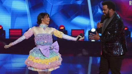 MASKED SINGER: LR: Gabby Douglas and host Craig Robinson & quot;  Road to the Finals - Final Clubs to the Mask!  / The Finale - One Last Mask!  & Quot;  The special two-hour season finale of Dancer aired on Wednesday, February 17 (8: 00-10: 00 PM ET / PT) on Fox.  © 2021 Fox Media LLC.
