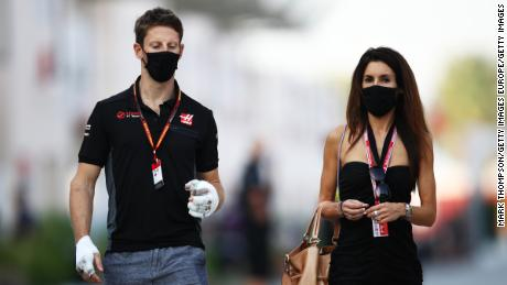 Grosjean and his wife Marion walk in the paddock ahead of the Sakhir Grand Prix in Bahrain.