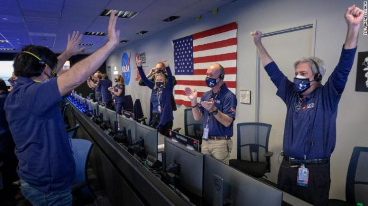 Members of NASA mission control celebrate after receiving confirmation that the Perseverance rover successfully touched down on Mars on Thursday, February 18.