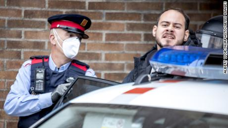 The rapper Pablo Hasél is arrested by police officers at the University of Lleida on Tuesday
