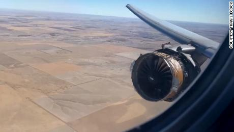 Passenger Travis Loock heard a loud boom, looked out his window and snapped this photo of the damaged engine on United Flight 328.
