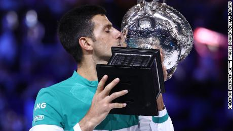 Novak Djokovic lifts the Australian Open title for the ninth time.