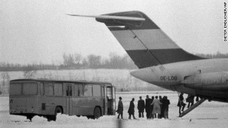 Hostages board a DC-9 in Vienna before they are flown to Algiers under guard of six terrorists, Dec. 22, 1975.