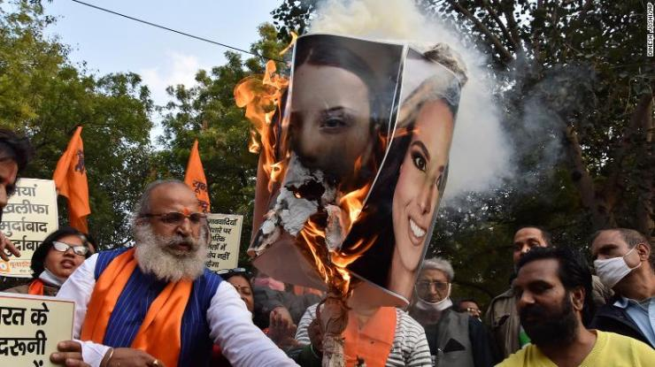 Crowds burn portraits of Meena Harris, niece of US Vice President Kamala Harris (right image), and Greta Thunberg in New Delhi, India, on  February 4.