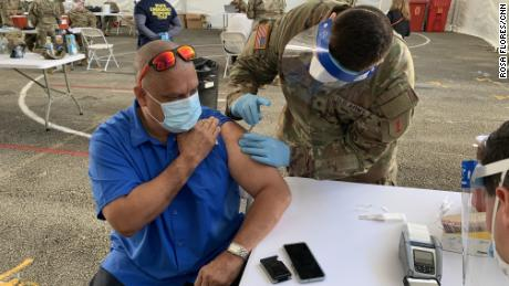 Guillermo Muñoz, principal of a school in Miami-Dade County, receives a Johnson & amp;  The Johnson vaccine was injected Wednesday at a FEMA-run site at Miami Dade College.