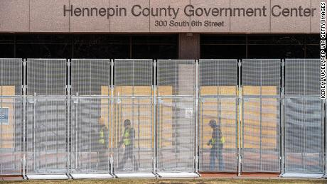 Workers install security fencing at the Hennepin County Government Headquarters in Minneapolis, Minnesota, on March 3, 2021.