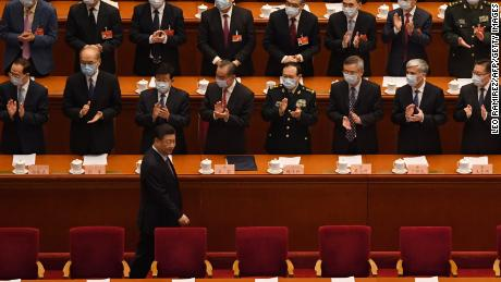 Delegates applaud as Chinese President Xi Jinping arrives for the opening ceremony of the Chinese People's Political Consultative Conference (CPPCC) at the Great Hall of the People in Beijing on March 4.