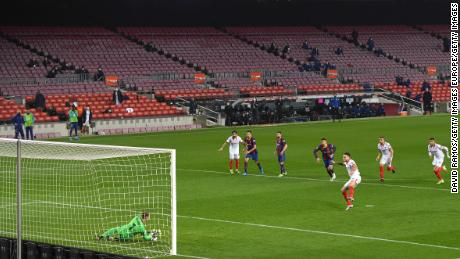 Marc-André ter Stegen of FC Barcelona saves Lucas Ocampos' penalty.