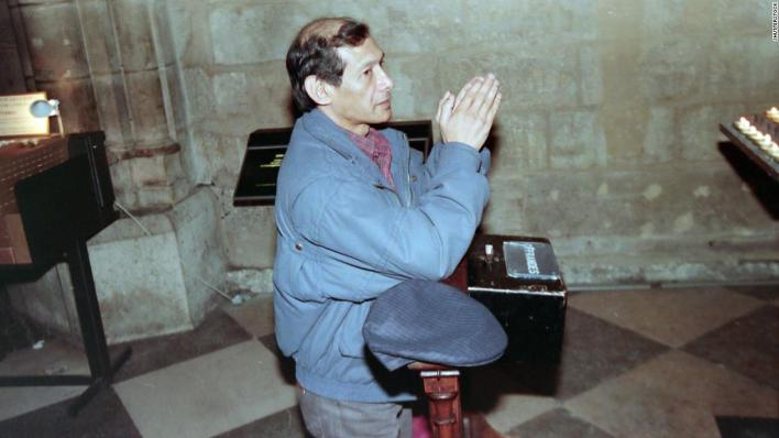 Sobhraj prays at Notre-Dame Cathedral, Paris in 1997 after being released from jail in India.