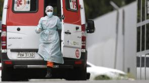 A healthcare worker arrives in an ambulance bringing a patient to HRAN Hospital in Brasilia, Brazil on March 8.