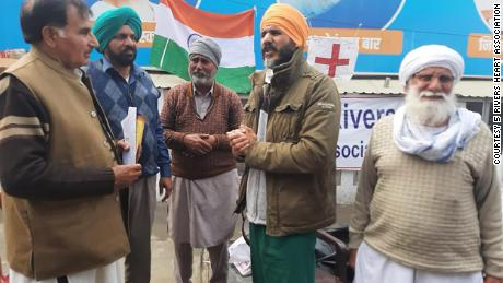 Dr. Swaiman Singh, second from right, stands with others at a protest site in New Delhi, India.