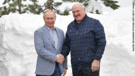 Russian President Vladimir Putin (left) shakes hands with his Belarussian counterpart Alexander Lukashenko during their meeting in Sochi, Russia, on February 22.