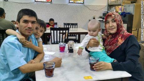 Mamutjan, his daughter Muhlise, his wife Muherrem and their young baby boy in Malaysia in 2015.