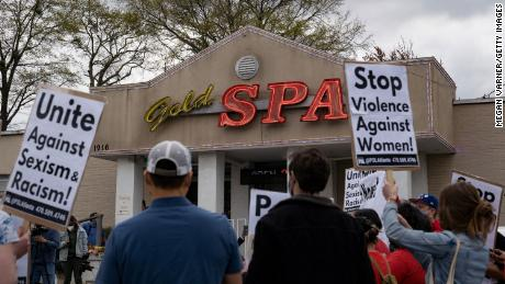 Activists demonstrate outside Gold Spa, the scene of one of the shootings, on March 18, 2021.