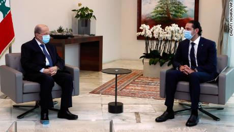 President Michel Aoun (left) meets with Prime Minister-designate Saad Hariri at the presidential palace on March 18.