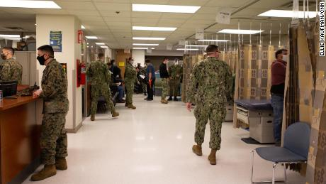 Sailors examine at the vaccination site at the Naval Medical Center Portsmouth on 15 March.
