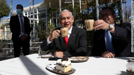 Netanyahu and Jerusalem Mayor Moshe Lion have a coffee and cake at a newly reopened restaurant in the city.